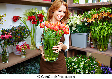 Florist corner - Portrait of young female florist with big...