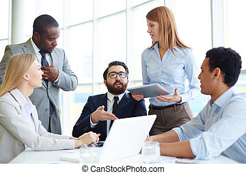Viewpoint - Group of business partners listening to their...