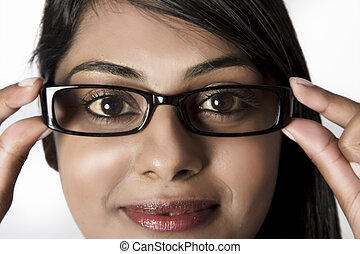 Model with brown eyes with framed glasses
