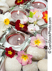 Flowers, candles and stones - Aromatherapy concept -...