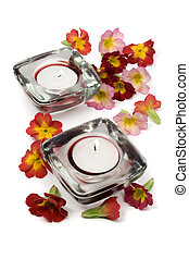 Aromatherapy concept - Flowers and scented candles isolated...