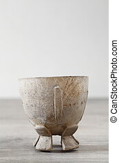 Antique wooden cup on wood table