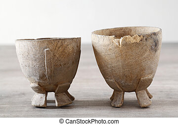 Twin antique wooden cup on wood table