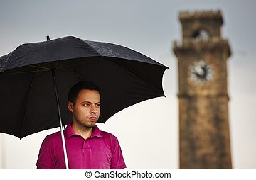 Man in rain - Man with black umbrella in rain