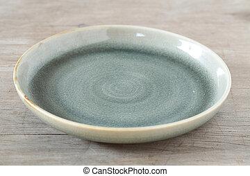 Antique ceramic dish wooden table