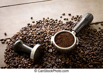 coffee filter and tamper on coffee beans
