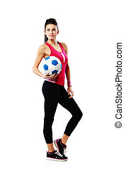 Full-length portrait of a young sport woman with soccer ball...