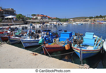 Multicolored fishing boats in Halkidiki, Greece -...