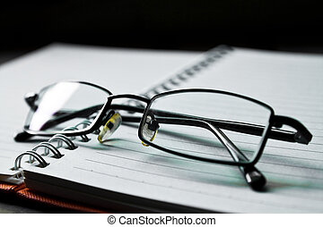 eyeglasses and book - eyeglass on the empty book