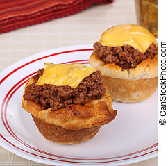 Sloppy Joe Biscuits - Two biscuits with sloppy joe meat and...
