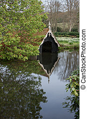 old boat house - boat house with reflections in water