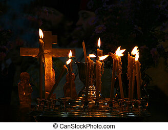 Candles and cross in the orthodox ukrainian church