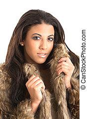 beautiful young woman fur coat