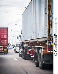 Truck with container on the road