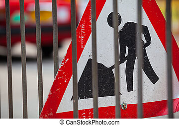 Roadworks - Sign of a construction site at a street behind a...