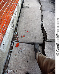 Walking on Broken Dangerous Sidewalk - Man walking on broken...