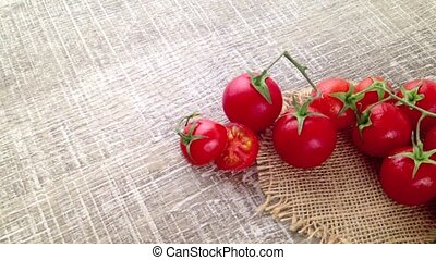 Bunch of wet tomatoes and rosemary