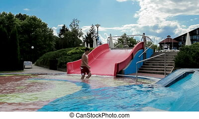 Happy boys on slide in the summer o
