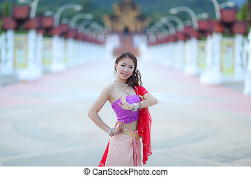 Thai dancing girl with northern style dress in temple,...