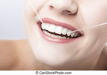 Caucasian Woman Mouth Closeup with Dental Floss.