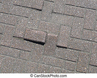 Uneven Bricks - Some uneven bricks on the ground.
