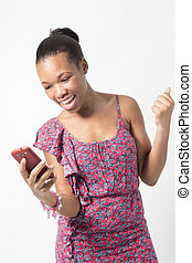 Young African woman excited over text message - Young Black...