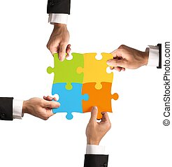 Teamwork and partnership concept - Businessman with puzzle...