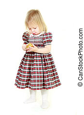 cute toddler girl with small giftbox over white