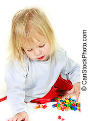 cute toddler girl with multiple colorful details over white