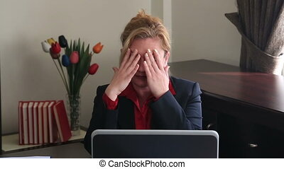 Businesswoman having headache