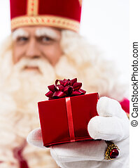 Sinterklaas showing gift - sinterklaas with gift typical...