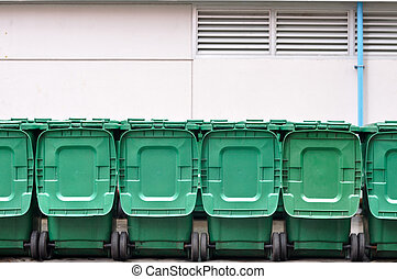 Many green bins arrange out door.