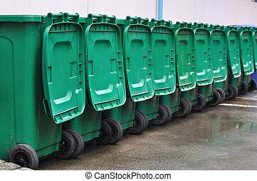 Many green bins arrange out door.