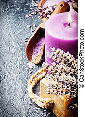 Wellness concept with lavender - Candle, lavender flowers...