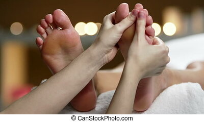 Giving Basic Foot Massage - Side angle of thai foot massage