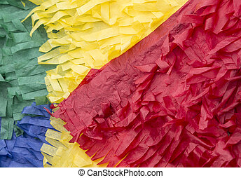 colorful pinata - a close up of a colorful paper pinata