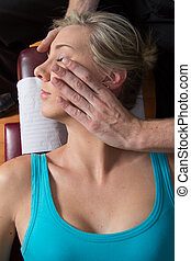 Chiropractor adjusting neck muscles young patient - Doctor...