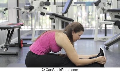 woman with sports body stretching - Young woman with sports...