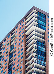 Red Brick Condos with White Balconies and Blue Windows