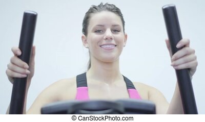 Walking Machine. woman exercising in the gym. Stairmaster