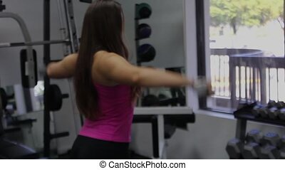 woman exercising in gym. Shoulders