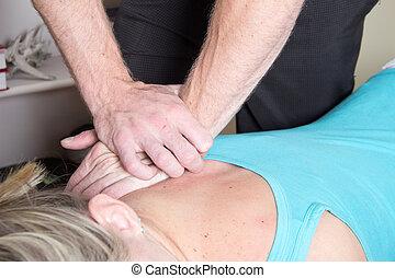 Chiropractor treating patient shoulder pressure -...