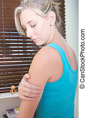 Young Female having the  arm pain