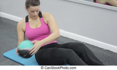 woman in sportswear exercising abdominals in gym