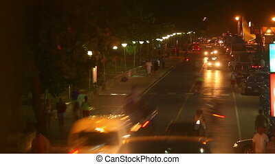 Night Traffic - Vehicles moving up and down the street at...