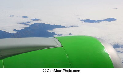 Aerial view from the cabin porthole of an airliner