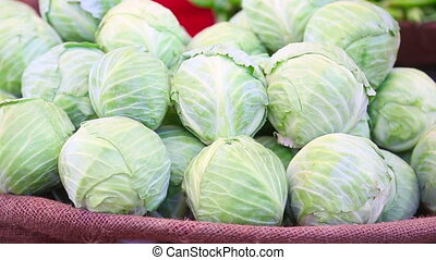 Vegetables - Stocks of cabbages and tomatoes displayed on...