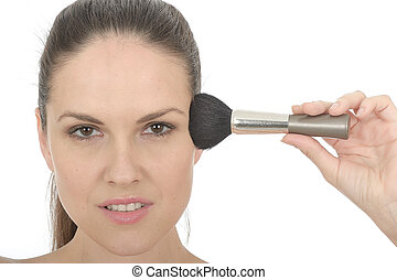 Attractice Young Woman Applying Face Powder