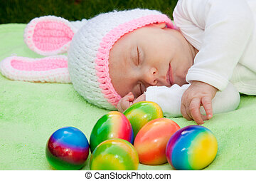 Baby in a bunny hat with Easter Eggs - Adorable sleeping...