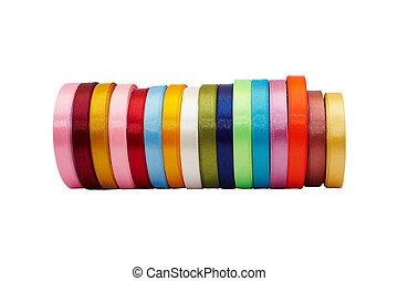Rolls of colored satin ribbons of different sizes
